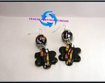 Black polymer clay flower earrings.