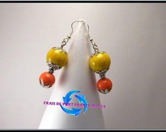 Orange yellow lampwork glass bead and glass bead earrings.