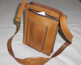Completely handmade gold leather bag