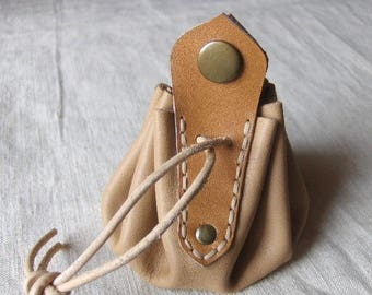 Coin purse is beige hand made leather with hand sewn applique