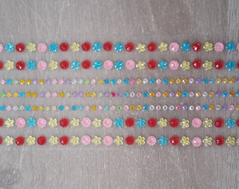 Round rhinestones and multicolored flowers