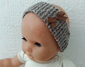 Mottled light brown headband enhanced with a pink satin bow. 0-3 months