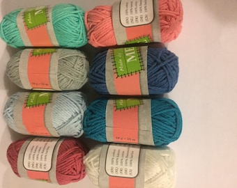 Balls of yarn from Mercerized cotton in a set of eight on very low prices