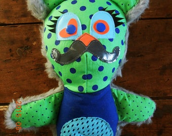 "Plush, cuddly ""Mister Eliot"" green and blue polka"