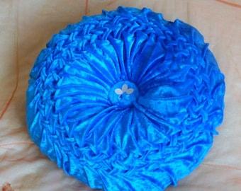 braided velvet cushion