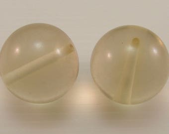 Set of 2 synthetic beads, 30 mm, champagne, translucent.