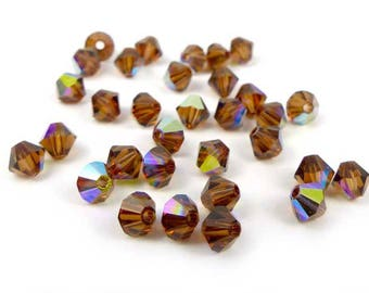 50 x polished 4 mm SMOKED TOPAZ AB bicone