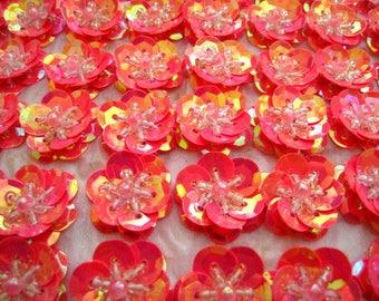 10 fleurs couleur rose reflets orangés AB 2cm sequins paillettes cousus.