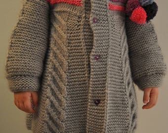 gray coat with rauyres and Pom Pom