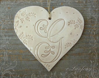 Large ceramic heart and beige lace letter 'G'