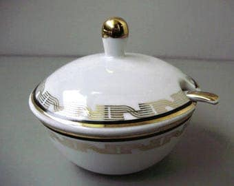 Vintage porcelain sugar bowl with spoon