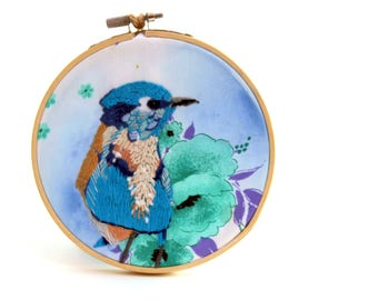 Blue bird. embroidery illustration. Embroidered illustration