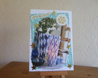 greeting card with vase of flowers and candle