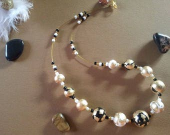 Gold, black and white colored necklace