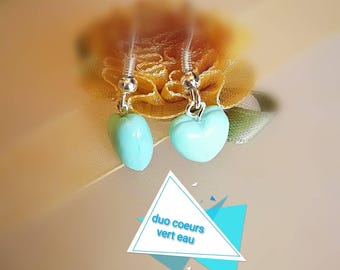 Watery green 3D heart mounted on silver plated dangling earrings