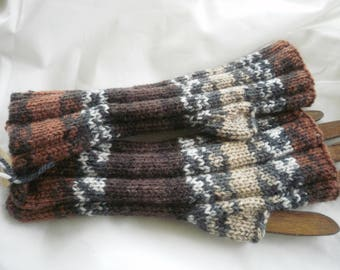 Knitted mittens handmade in a changing in different shades of beige and Brown yarn