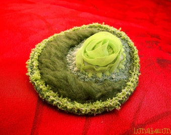 Brooch in various green and khaki fabric, colorful threads