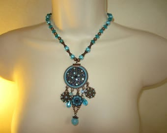 Blue bronze and blue pendant necklace
