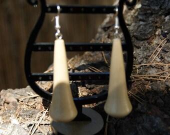 Cutaway hand earrings in chestnut wood