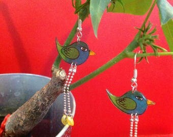 Bird with shrink plastic earrings.