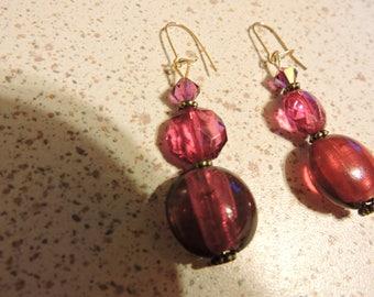 Nice pair of earring is plum.