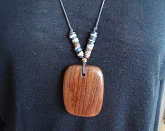 Pendant composed of a great piece of wood and African glass paste beads