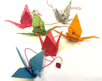 Strings of colorful handmade origami cranes garland