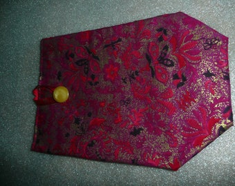 Red gift bag in red and gold fabric