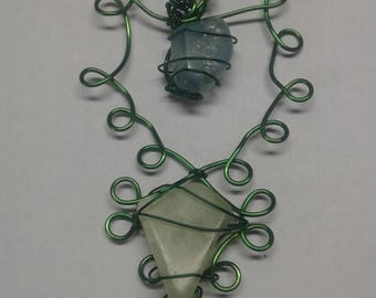Green wire wrapped 2 stone pendant
