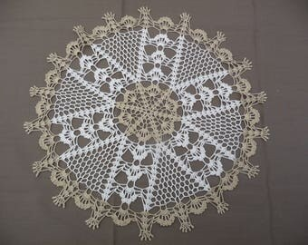 Handmade crochet in ecru and beige cotton lace doily.