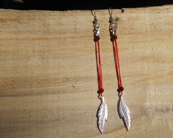 Silver feather and Red dangle earrings