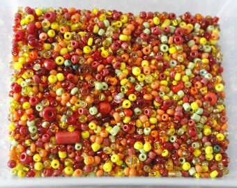 210g of multicolored seed beads: yellow, Orange and Red