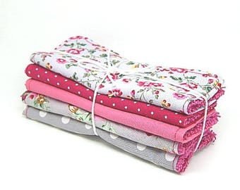 5 large baby wipes or cleansing rose and Fuchsia