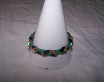 Bracelet with jersey and nuts Golden, black, green and black tones