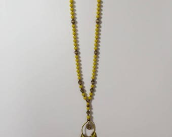 Necklace beads and yellow faceted gems.