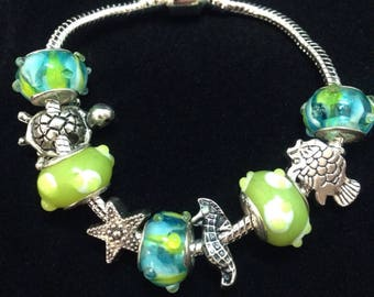 Underwater World Handmade Charm Bracelet / Starfish, Seahorse, Turtle and Fish silver charms just for her / 3D Lampwork Murano Glass Beads