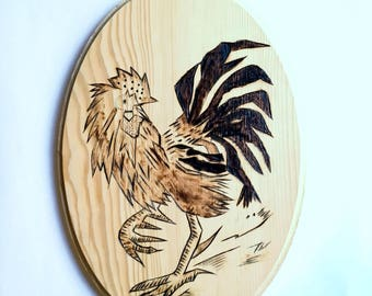 Pyrography on wood with a small fighting cock