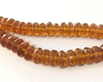 X 25 PCs glass beads faceted 8 x 5 mm