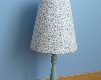 Lampshade and a blue lamp base