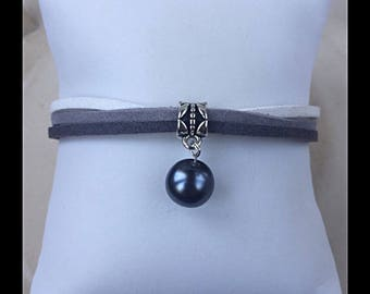 Gray suede and glass bead bracelet.