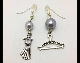 "Earrings ""dress on hanger"" mismatched"