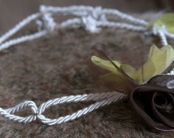Silver rope headband and flower