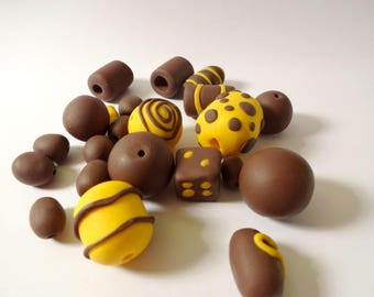 Assorted beads - yellow and Brown polymer clay