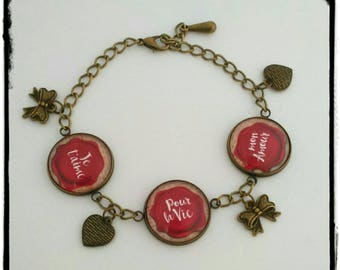 """Bronze bracelet with three cabochons """"declaration of love on a beige background"""""""