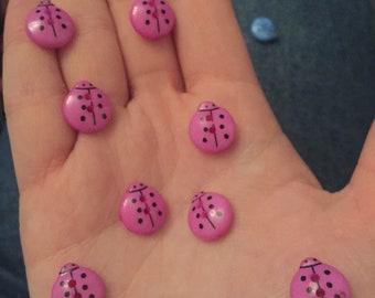 11 light pink/ purple ladybird buttons