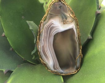 Agate wrapped in distressed brass