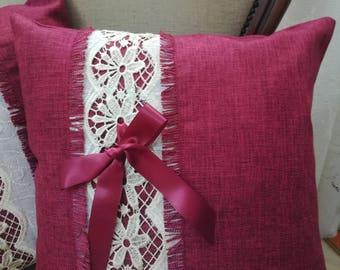 Burgundy cushion with macramé lace and bow