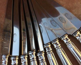 "lot 55, 10 ""ERCUIS PARIS"" silver plated knives."
