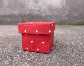 Little red box with white polka dots.
