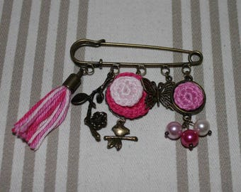 Pink and antique bronze pin